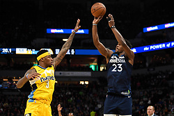 December 27, 2017 - Minneapolis, MN, USA - The Minnesota Timberwolves' Jimmy Butler (23) attempts a 3-point shot but is fouled by the Denver Nuggets' Torrey Craig (3) in the second quarter on Wednesday, Dec. 27, 2017, at Target Center in Minneapolis. (Credit Image: © Aaron Lavinsky/TNS via ZUMA Wire)