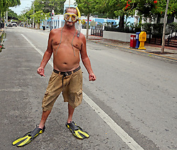 September 9, 2017 - Key West, Florida, U.S. - Raymond Captain is prepared to rescue people as he stands on Duval Street in Key West, Fla., on Saturday, Sept. 9, 2017. Hurricane Irma is approaching the Florida Keys and some residents refused to be evacuated. (Credit Image: © Charles Trainor Jr/TNS via ZUMA Wire)