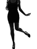 stylish sexy silhouette caucasian beautiful woman legs on studio isolated white background