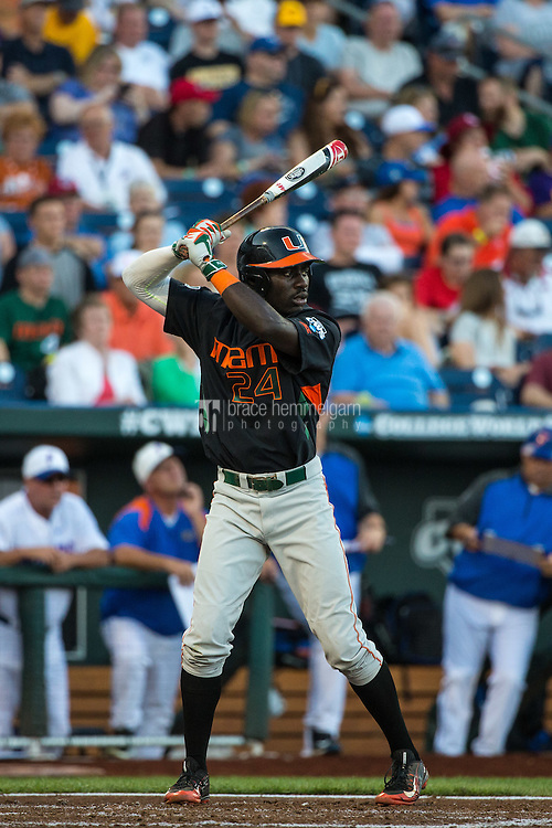 Jacob Heyward (24) of the Miami Hurricanes bats during a game between the Miami Hurricanes and Florida Gators at TD Ameritrade Park on June 13, 2015 in Omaha, Nebraska. (Brace Hemmelgarn)