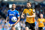 Cambridge United Defender, Greg Taylor (2) and Portsmouth Forward, Nicke Kabamba (15) chase the ball during the EFL Sky Bet League 2 match between Portsmouth and Cambridge United at Fratton Park, Portsmouth, England on 22 April 2017. Photo by Adam Rivers.