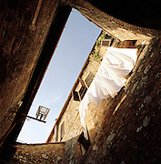 Sheets hanging from a window, Siena, Italy