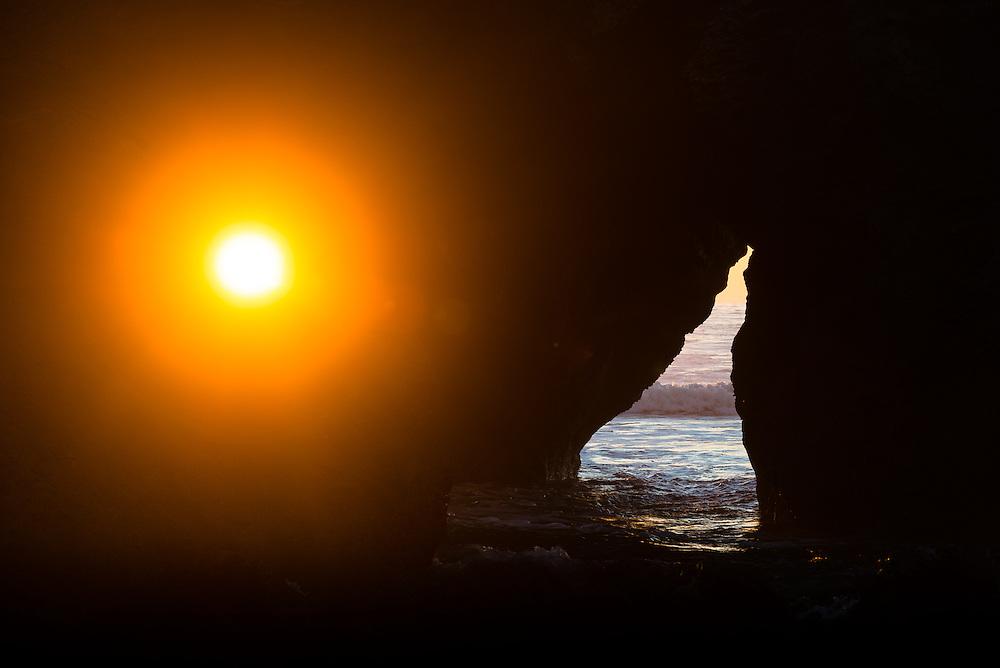 Sunlight streams through Needle Rock