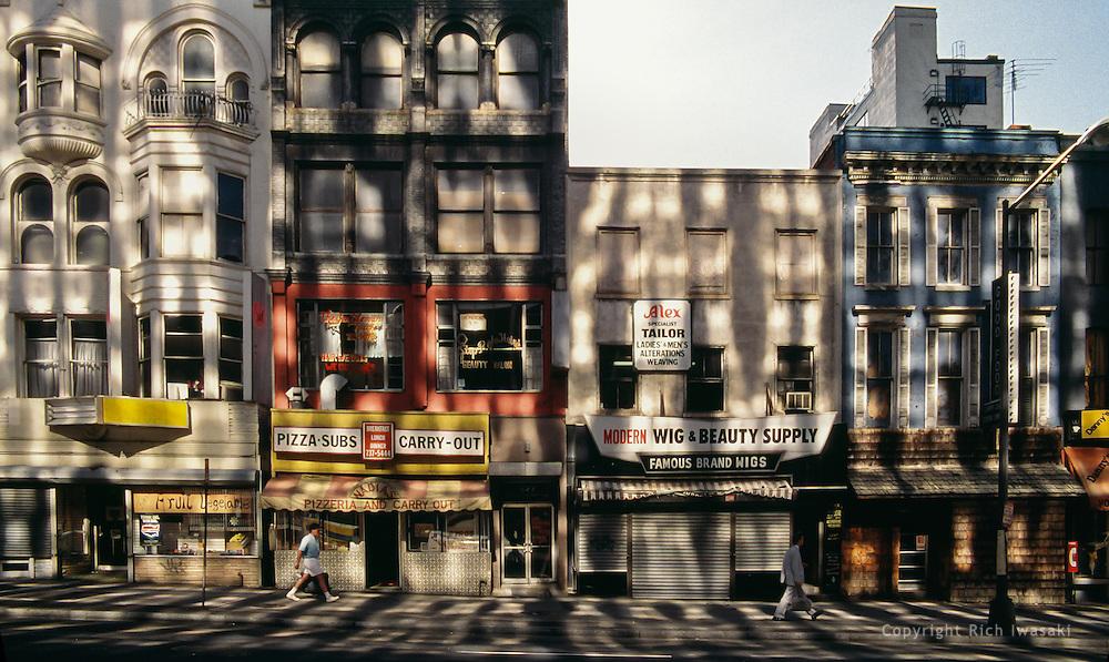 Sunlight reflects pattern onto buildings along a street in Washington, DC, USA