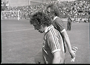 League of Ireland vs Liverpool FC.    (M87)..1979..18.08.1979..08.18.1979..18th August !979..In a pre season friendly the League of Ireland took on Liverpool FC at Dalymount Park Phibsborough,Dublin. The league team was made up of a selection of players from several League of Ireland clubs and was captained by the legendary John Giles. Liverpool won the game by 2 goals to nil..The scorers were Hansen and McDermott..Picture shows the team captains, John Giles and Phil Thompson, leading out their teams to a packed Dalymount Park.