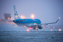 © Licensed to London News Pictures. 27/02/2018. Leeds UK. A KLM aircraft takes of in the snow this morning at Englands highest airport Leeds Bradford International in Yorkshire. Photo credit: Andrew McCaren/LNP