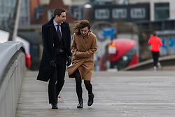 © Licensed to London News Pictures. 09/02/2020. London, UK. A couple struggle to walk across London Bridge during windy weather this morning. Rain and windy weather is forecast today as Storm Ciara reaches the capital. Photo credit: Vickie Flores/LNP