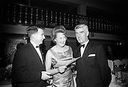 17/2/1966<br /> 2/17/1966<br /> 17 February 1966<br /> <br /> Mr. Finbar Ambrose Manager Economic Studies Henry Ford and Son Ltd. chatting with Miss Moira Smith of the F.I.I and Mr Vincent Manahan Personnel Manger Sunbeam at the Reception prior to the Dinner