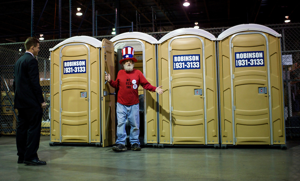 Christopher Collopy, from Spring City, Pennsylvania emerges from a portable restroom before a rally for U.S. Republican presidential candidate, former Massachusetts Governor Mitt Romney, along with Florida Senator Marco Rubio at Mustang Expediting in Aston, Pennsylvania on April 23, 2012.