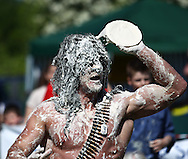 Coxheath, Kent - Saturday, May 22nd 2010: Joel Hicks of Leicester in action during the World Custard Pie Championships at Coxheath near Maidstone, Kent. His team, The Modern Family, were eliminated in the semi-finals. The first championship was held in 1967 in Coxheath using a special custard recipe developed by Richard Hearn aka Mr Pastry. The championship is made up of teams competing in heats, semi finals and the final, with the number of pies available per team increasing from 5 in the heats to 10 in the final. 6 points are scored for a direct hit on the face, 3 points for the shoulders or upwards, 1 point for any other part of the body, and points are deducted for misses. A discretionary 5 points can be awarded for the most amusing and original throwing technique. The event is part of the Rotary Club funday. (Pic by Andrew Tobin/SLIK Images)