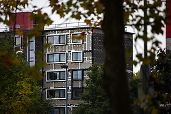 © Licensed to London News Pictures . 11/10/2018. Salford , UK . GV of Plane Court with temporary cladding stripped back to the original brick-work . Recently installed cladding at several council-owned tower blocks in Salford has been identified as having similar dangerous properties to that which was installed on the Grenfell Tower in London . Residents have been waiting months for clarification on what action will be taken to make their homes safe . Photo credit : Joel Goodman/LNP