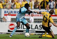 Shola Ameobi - Newcastle scores his first goal. Frode Kippe - Lillestrøm tries to stop him.<br /> <br /> Photo: Peter Tubaas/Digitalsport<br /> Lillestrøm v Newcastle<br /> Intertoto Cup<br /> 22 July 2006<br /> Arasen, Lillestrom, Norway.