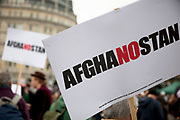 """Afghanostan placard. Protest in central London to mark 10 years of the conflict in Afghanistan. Musicians, actors, film-makers and MPs are joining protesters for the Anti-war Mass Assembly in Trafalgar Square. The Stop The War Coalition said up to 5,000 people were at the protest but a BBC correspondent estimated there were about 1,000 people in the square. The coalition says opinion polls show most British people want a """"speedy withdrawal"""" of UK forces. The demo brought together people from many groups in solidarity."""