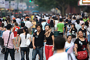 Pedestrians walk Shanghai's most commercial avenue, Nanjing Road, on Wednesday, July 24, 2007. Photo by Lucas Schifres/Pictobank.