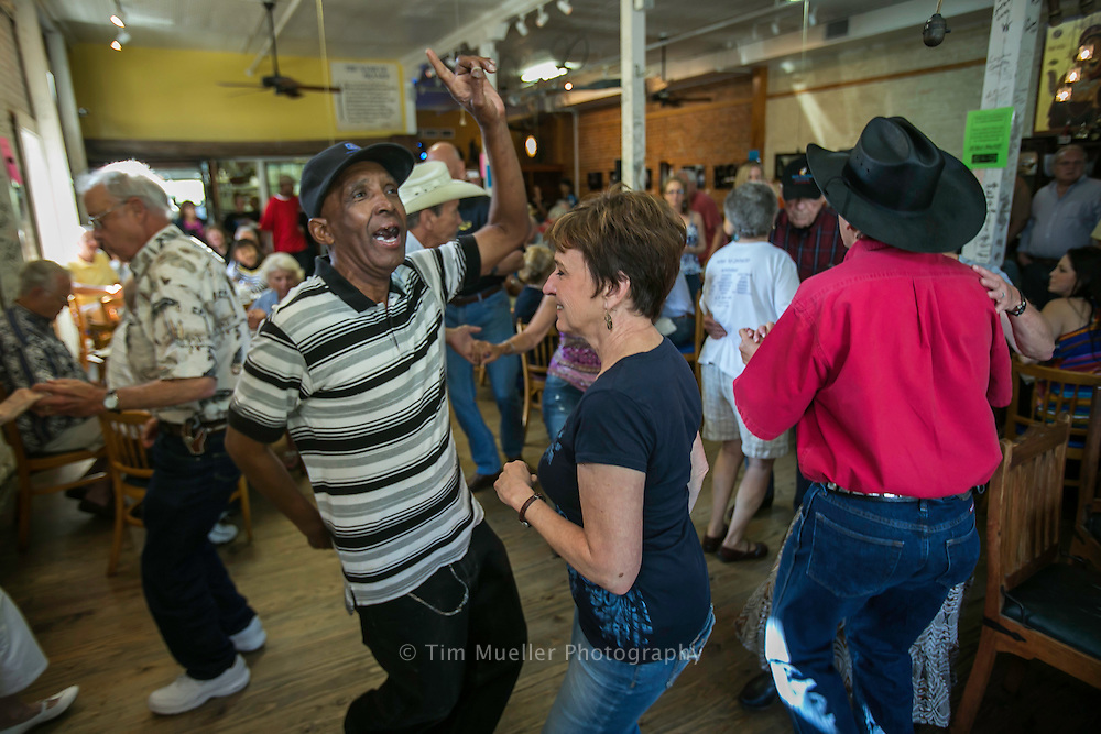 Duplantis Pierre, left, and Annette Tremie dance as Corey Ledet and his Zydeco band perform Saturday morning during the Cafe Des Amis Zydeco Breakfast in Breaux Bridge, Louisiana.