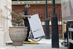 © Licensed to London News Pictures. 30/07/2018. London, UK.  Removal men taking a box into a van outside the Foreign Secretary's official residence at Carlton Gardens in central London where the former Foreign Secretary, Boris Johnson is moving out following his resignation.  Photo credit: Vickie Flores/LNP