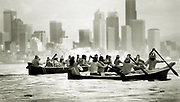 Nearing the end of their historic 170-mile journey, Quileute and Hoh Indians paddle their canoes across Elliott Bay toward Alki, with a final destination of Golden Gardens. (Alan Berner / The Seattle Times, 1989)