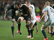 Liam Messam of the All Blacks on the charge trying to break the tackle of Chris Ashton of England during the third rugby test between the All Blacks and England played at Waikato Stadium in Hamilton during the Steinlager Series - All Blacks v England, Hamiton, 21 June 2014<br /> www.photosport.co.nz