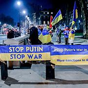 Anti-Putin Ukrainian protest outside Downing Street with banner #FreeSentsov on 11th December 2018, London, UK.