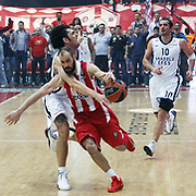 Olympiacos's Vassilis Spanoulis (F) and Anadolu Efes's Kerem Gonlum (L) during their Turkish Airlines Euroleague Basketball playoffs Game 5 Olympiacos between Anadolu Efes at SEF Indoor Hall in Piraeus, in Greece, Friday, April 26, 2013. Photo by TURKPIX