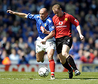 Photo. Richard Lane, Digitalsport.<br /> Portsmouth v Manchester United. FA Barclaycard Premiership. 17/04/2004.<br /> Steve Stone battles with Nicky Butt.