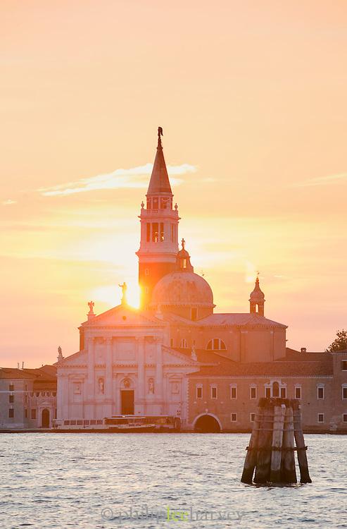 Sunrise at the Church of San Giorgio Maggiore and the Canale della Diudecca on the island of San Giorgio Maggiore, Venice Italy, Europe