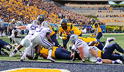Sep 22, 2018; Morgantown, WV, USA; West Virginia Mountaineers running back Leddie Brown (4) runs the ball near the goal line during the second quarter against the Kansas State Wildcats at Mountaineer Field at Milan Puskar Stadium. Mandatory Credit: Ben Queen-USA TODAY Sports