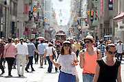 Istiklal Street, one of the most famous avenues in Istanbul, Turkey, visited by nearly 3 million people in a single day over the course of weekends. Located in the historic Beyoglu district, it is roughly three kilometres long, housing boutiques, bookstores, art galleries, theatres, libraries, cafés and restaurants..The avenue, surrounded by late Ottoman era buildings starts from the medieval Genoese neighbourhood around Galata Tower and ultimately leads up to Taksim Square...Istanbul 7 June 2012