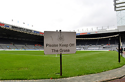 General view of a please keep off the grass sign pitchside at St James' Park before the game