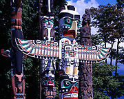 Pacific Northwest Coast totem poles including the Thunderbird House Post, a replica carved in 1987 by Tony Hunt of the house post created by Kwakwaka'wakw artist Charlie James in the early 1900s.  On display at Stanley Park, Vancouver, British Columbia, Canada.