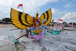 August 13, 2017 - Bali, Indonesia - To celebrate the 72nd Indonesia's Independence Day on August 17th, Indonesian fisherman decorated their fishing boats with ornaments themed Indonesia like Garuda Bird, on 13 August 2017 at Jimbaran Beach, Bali. One of them is a Garuda Bird, the national symbol. This festival is a symbol of a reminder that Indonesians believe their ancestors were fishermen. (Credit Image: © Keyza Widiatmika/NurPhoto via ZUMA Press)
