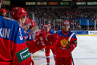 KELOWNA, BC - DECEMBER 18: Grigory Denisenko #28 of Team Russia fist bumps players on the bench to celebrate a second period goal against Team Sweden at Prospera Place on December 18, 2018 in Kelowna, Canada. (Photo by Marissa Baecker/Getty Images)***Local Caption***