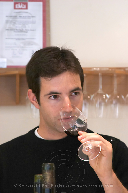 Simon Abrivard Mas La Chevaliere. near Beziers. Languedoc. Tasting wine. France. Europe. In the professional tasting room.