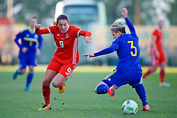 ZENICA, BOSNIA AND HERZEGOVINA - Tuesday, November 28, 2017: Wales' Kayleigh Green and Bosnia and Herzegovina's Antonela Radeljić during the FIFA Women's World Cup 2019 Qualifying Round Group 1 match between Bosnia and Herzegovina and Wales at the FF BH Football Training Centre. (Pic by David Rawcliffe/Propaganda)
