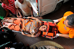 September 27, 2016 - Kathmandu, NP, Nepal - Hospital staffs carrying an injured passenger towards Tribhuwan university teaching hospital in Kathmandu for treatment as rescued from fell around 200 meters down near Pantatar of Marpak. The bus was heading towards to kintang phedi from Dhading. (Credit Image: © Narayan Maharjan/Pacific Press via ZUMA Wire)