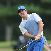 Rory McIlroy chips from the top of the bunker on the eleventh hole during the third round of theThe Barclays Golf Tournament at The Ridgewood Country Club, Paramus, New Jersey, USA. 23rd August 2014. Photo Tim Clayton