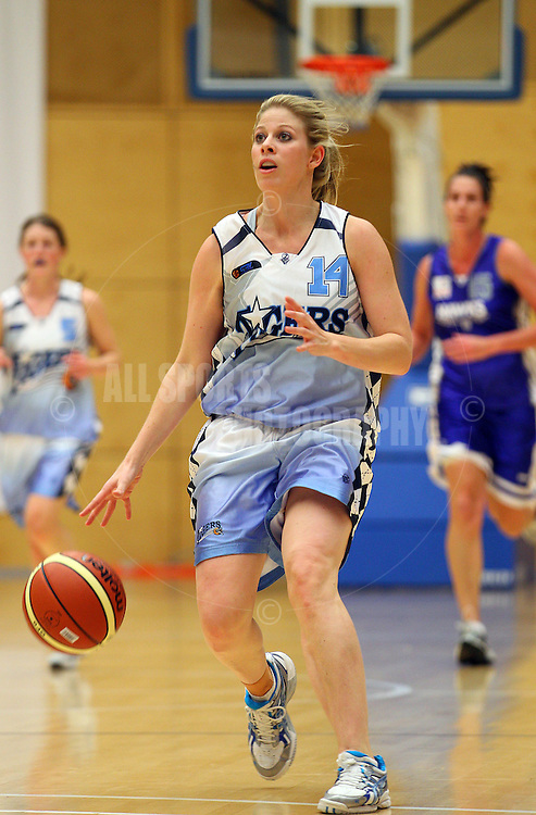 PERTH, AUSTRALIA - JULY 16: Melissa Marsh of the Tigers brings the ball down the court during the week 18 SBL game between the Perry Lakes Hawks and the Willetton TIgers at The State Basketball Center on July 16, 2011 in Perth, Australia.  (Photo by Paul Kane/All Sports Photography)