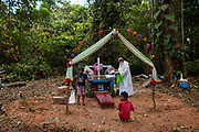 Father Pablo Zavala offers a mass for the death of a person from the San Jose de Kareme community in the Peruvian Amazon.