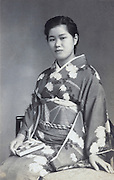 young adult woman posing in traditional kimono Japan 1930s 1940s