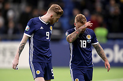 Scotland's Oliver McBurnie (left) and Johnny Russell (right) appear dejected after the final whistle during the UEFA Euro 2020 Qualifying, Group I match at the Astana Arena.