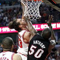 14 March 2012: Chicago Bulls center Joakim Noah (13) dunks the ball over Miami Heat center Joel Anthony (50) during the Chicago Bulls 106-102 victory over the Miami Heat at the United Center, Chicago, Illinois, USA.