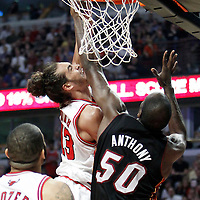 14 March 2012: Chicago Bulls center Joakim Noah (13) dunks the ball over Miami Heat center Joel Anthony (50) during the Chicago Bulls 106-102 victory over the Miami Heat at the United Center, Chicago, Illinois, USA.