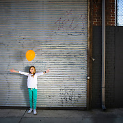 Young girl with balloon. Hollywood, CA.