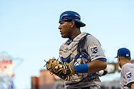Salvador Perez #13 of the Kansas City Royals heads for the dugout between innings against the Minnesota Twins on June 27, 2013 at Target Field in Minneapolis, Minnesota.  The Twins defeated the Royals 3 to 1.  Photo by Ben Krause