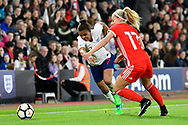 Nikita Parris (7) of England on the attack as Charlotte Estcourt (17) of Wales chalenges during the FIFA Women's World Cup UEFA Qualifier match between England Ladies and Wales Women at the St Mary's Stadium, Southampton, England on 6 April 2018. Picture by Graham Hunt.