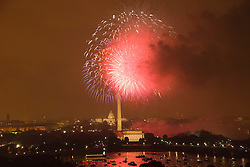 Washington DC; USA: July 4 Fireworks and icons, as seen from Arlington VA venue, Top of the Town.Photo copyright Lee Foster Photo # 16-washdc82914