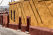 A colorful wall and home along Santo Domingo Street in San Miguel de Allende, Mexico.