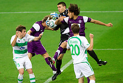Nacer Barazite of FK Austria Wien (R) vs Elvis Dzafic, goalkeeper of NK Olimpija Ljubljana during football match between NK Olimpija Ljubljana (SLO) and FK Austria Wien (AUT) of 1st Leg of Europa League Third Qualifying Round, on July 28, 2011, in SRC Stozice, Ljubljana, Slovenia.   (Photo by Vid Ponikvar / Sportida)