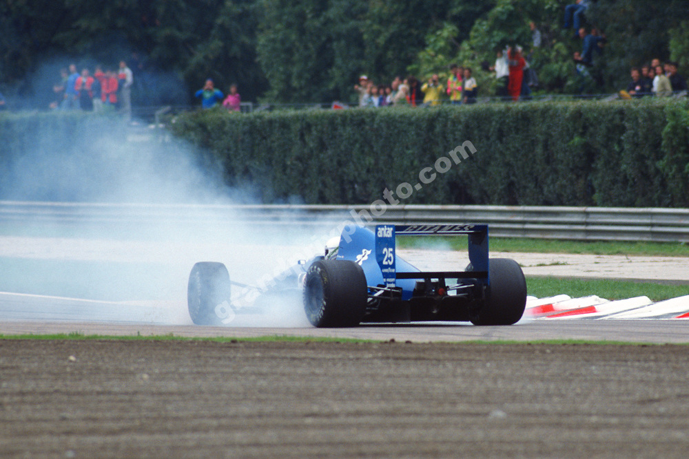 Rene Arnoux (Ligier-Ford) spins during practice for the 1989 Italian Grand Prix in Monza. Photo: Grand Prix Photo
