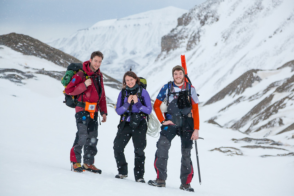UNIS students from nearby Longyearbyen – Stephen Jennings (l-r), Kiya Riverman, and Nate Stevens – at the foot of Larsbreen, Svalbard on a glacier caving expedition.
